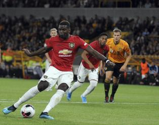 Pogba's penalty miss crucial in Molineux draw